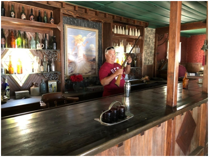 Mark checking out the goods behind the bar at the hotels saloon
